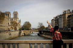 Ici Paris (Calinore) Tags: city bridge woman paris france seine cathedral femme tourist notredame pont ville tourisme cathedrale fleuve touriste