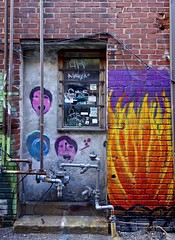 Fire in the Alley (ricko) Tags: streetart brick fire graffiti alley knoxville tennessee pipes wires marketsquare