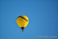 April 3, 2016 - Bright yellow balloon against bright blue skies. (Michelle Jones)