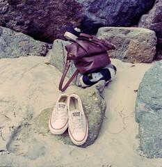 Sands on Shoes off (methezer) Tags: california vacation color film beach analog sand shoes rocks kodak purse converse coronado allstar chucks chucktaylor belongings