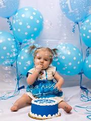 Day 110: Happy Birthday Caitlin! (adamsarasin) Tags: birthday blue portrait cake balloons studio children child daughter birthdaycake firstbirthday frosting cakesmash
