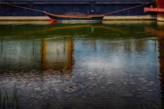 A dinghy (ramerk_de) Tags: reflection water harbor regensburg hdr shippingbunker