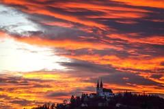 Burning Heaven (karlbauernhansl) Tags: blue houses sunset orange church yellow clouds linz austria sterreich sonnenuntergang hill kirche wolken gelb blau obersterreich huser pstlingberg upperaustria