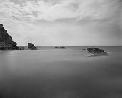 Cabo Rojo Sea Rocks (GOJR.) Tags: longexposure beach analog puertorico 6x7 rodinal orangefilter mamiyarb67pros standdevelopment meduimformat farodecaborojo 10stopsndfilter mamiyasekor50mmf45 fujifilmneopanacross100 leebigstopper