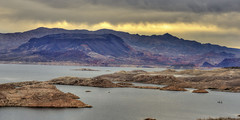 Pastel Shore (magnetic_red) Tags: sky lake storm mountains water clouds sunrise island boat colorful pastel nevada scenic dramatic stormy shore lakemead
