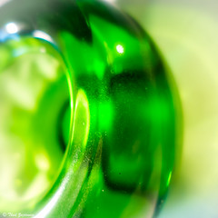 Crescent (Thad Zajdowicz) Tags: leica light shadow abstract blur color colour macro green glass closeup digital square dof bright bokeh availablelight maryland indoor crescent depthoffield curve bethesda lightroom montgomerycounty 1x1format zajdowicz