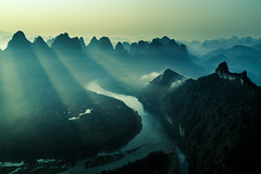 Mystic Li River (One_Penny) Tags: china morning travel light sky sun mountains nature water sunrise river landscape photography liriver village view yangshuo hills land layers colourful sunrays tones karst lijiang lightrays guangxi xingping karsthills canon6d damianhill