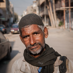 """Nobody has ever taken my photo"" (Fortunes2011. Season's Greeting & Peace to ALL) Tags: street pakistan portrait man hat scarf square beard sad poor oldman 11 beggar karachi sindh nikond80 ancholi fortunes2011"