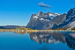 The Wetterhorn as reflected on the The Fallbodensee.  Canton of Bern , Switzerland. No. 1414. (Izakigur) Tags: lake mountains alps reflection alpes landscape lago liberty schweiz switzerland flickr suisse suiza swiss lac be bern grindelwald svizzera alpi berne eiger bernois interlaken berna dieschweiz musictomyeyes sussa oberland wetterhorn suizo myswitzerland lasuisse kantonbern oberlandbernese oberlandbernois nikond700 nikkor2470f28 izakigur suisia laventuresuisse