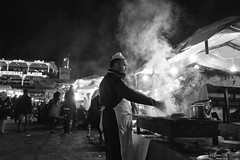 Brochette... (enzo marcantonio) Tags: africa street leica city travel people blackandwhite bw food night work square outside person holidays place outdoor cook streetphotography grill eat barbecue enzo marocco marrakech souk streetphoto q streetfood summilux ethnicity jamaaelfna brochette marcantonio leicaq enzomarcantonio