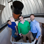 Dr. Oberst and students with telescope.