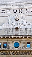 Clock of Caixa Catalunya bank in Barcelona, Spain
