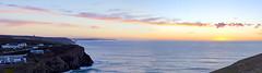 Porthtowan sunset (112/366) (AdaMoorePhotography) Tags: blue sunset sea sky orange sun holiday seascape nature water yellow clouds landscape coast spring nikon cornwall waves natural sunny cliffs day112 porthtowan 366 d7200