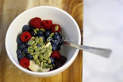 fruit salad for breakfast (ggcphoto) Tags: food closeup fruit breakfast berries bowl fruitsalad freshness choppingboard pumpkinseeds redberries appleslices healthyeating