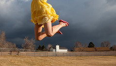 Dark clouds (Flickr_Rick) Tags: woman storm girl clouds outside spring jump jumping legs skirt jumpology