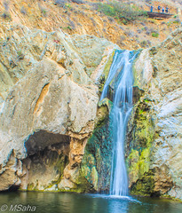 Paradise Falls (Mrinmoy Saha) Tags: world life travel blue light shadow red mountain color green nature water colors beautiful look rock landscape happy waterfall globe nikon stream soft quiet peace view bright earth top vibrant hill wide rocky vivid peaceful calm sharp adventure clear around lonely tall manual moment dslr capture dim legend panaromic lively d52000