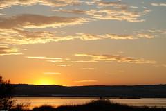 Sun hiding behind the hills (jsbfin) Tags: sunset sky sun lake clouds spain glow dusk horizon torrevieja