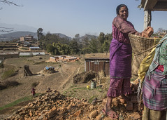 Uma's mother has been working on the house for the past four months (Handicap International UK) Tags: nepal earthquake uma kathmandu survivors disability silwal