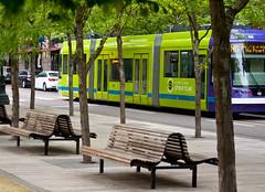 Portland Streetcar Jamison Square (Orbmiser) Tags: max oregon portland spring nikon cityscape transportation lightrail streetcar d90 jamisonsquare 55200vr
