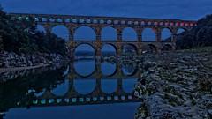 Pont du Gard (egeaguy) Tags: bridge france reflection water night eau roman pierre unesco aqueduct reflet pont nimes pontdugard nuit romain languedoc gard aqueduc
