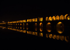 a view of the si-o-seh bridge at night highlighting the 33 arches, Isfahan Province, isfahan, Iran (Eric Lafforgue) Tags: city travel bridge urban reflection building tourism horizontal architecture night buildings outdoors persian asia arch iran middleeast bridges engineering persia arches nobody landmark architectural illuminated civil iranian copyspace centralasia esfahan isfahan ispahan siosehpol   siosehbridge  iro isfahanprovince  colourpicture polesioseh  hispahan iran034i3695
