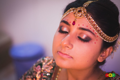 Bride is almost ready, the dots on the head are typical of a Gujrati bride's makeup