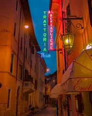 Rainy Evening on Via Dietro Pallone (Pino Snorr) Tags: street streets colors sign bar evening streetphotography via rainy verona ligth pallone dietro trattoria veneto viadietropallone