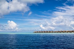 Maldives (mr-mojo-risin) Tags: ocean travel blue sea sky cloud beach water clouds landscape seaside sand holidays escape crystal outdoor dream resort clear shore destination maldives luxury stilt bungalows