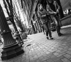 A Walk Through Old Town (TMimages PDX) Tags: road street city people urban blackandwhite monochrome buildings portland geotagged photography photo image streetphotography streetscene sidewalk photograph pedestrians pacificnorthwest avenue vignette fineartphotography iphoneography
