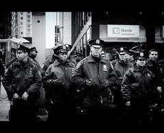 Safest Bank in Manhattan! (Dan Haug) Tags: nyc blackandwhite monochrome waiting uniform manhattan hats police nypd bank newyearseve fujifilm safe lineup officers tdbank xt1 xf35mmf14r