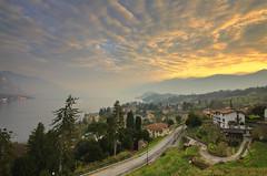 Sunrise over Bellagio (Rich3012) Tags: road morning sky italy lake como clouds sunrise landscape dawn bellagio lombardy