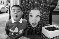 wow! cherries! (nzfisher) Tags: boy newzealand blackandwhite monochrome childhood fruit canon children cherry mono cherries child portraiture southisland dunedin 24mm boyhood