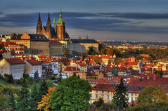 Prague Castle Autumn Sunset (Radim Klimek) Tags: autumn trees sunset orange tower castle fall church colors leaves yellow architecture buildings downtown prague cathedral district centre gothic praha center mala petrin vitus hradcany strana