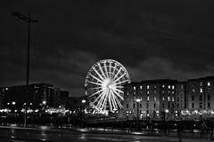 The Wheel , Liverpool by night (cathbooton) Tags: winter england blackandwhite reflection rain wheel night liverpool canon darkness nighttime february friday albertdock merseyside