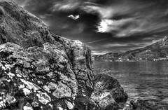Salty rocks (theseustroizinian) Tags: sea bw seascape monochrome canon landscape blackwhite seaside corinth hellas greece hdr loutraki peloponnese seasunandclouds canoneos700d simplysuperb hdraward eos700d
