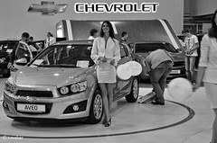 At the Motor Show BW (t-maker) Tags: auto show light portrait people blackandwhite bw woman white black chevrolet industry girl monochrome beautiful beauty face car fashion pose hall stand spring model nikon automobile europe noir legs noiretblanc market modeling candid centre leg crowd balloon young bored documentary makeup posing social ukraine exhibition company event international vehicle searchlight motor column presentation emotional knees knee kiev showcase miniskirt kyiv sia floodlight motorshow spontaneous aveo manufacturer showcasing d5100 siamotorshow siaautoshow