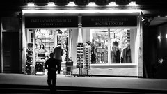 tourist shopping after dark (byronv2) Tags: street blackandwhite bw monochrome shop night shopping scotland blackwhite edinburgh nacht candid royalmile oldtown nuit edimbourg touristshop edinburghbynight