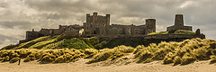 Bamburgh Castle from the Beach (Brian Travelling) Tags: england building castle beach architecture sand pentax dunes historic northumberland bamburgh archeology sanddunes seagrass bamburghcastle pentaxkr