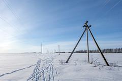 Triple pylon (andrey.senov) Tags: russia kostroma province spring snow sun sky clouds field          fujifilm fuji xa1 fujifilmxa1 45faves