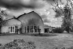 Glass House in Black & White. (ManOfYorkshire) Tags: old bw house building glass monochrome gardens architecture botanical construction unique panes olympus structure palm study devon oldest bicton sh2 1820s 18000