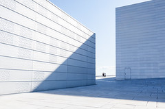 (Svein Skjåk Nordrum) Tags: blue light shadow people lines oslo norway opera couple pattern exterior graphic geometry perspective shapes surface oslooperahouse dennorskeoperaballett