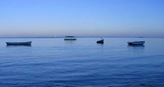 Blue sunrise (Fabrice T.) Tags: ocean voyage travel blue light sky mer seascape beach water beautiful azul coast boat agua nikon eau maurice bleu ciel cielo mauritius plage crepuscule aurore