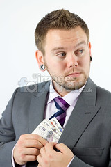 Stealing Money (the UMF) Tags: people white money color male men english vertical businessman bad cash business suit indoors photograph thief illegal studioshot concept pocket theft currency sneaky isolated suspicious stealing oneperson finance caucasian youngmen realpeople robbing isolatedonwhite