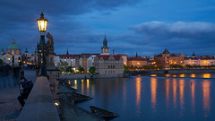 In Prague (McQuaide Photography) Tags: old city longexposure travel bridge light building history tourism water stone skyline architecture zeiss river outside twilight streetlight europe prague outdoor dusk widescreen sony tripod praha landmark panoramic historic czechrepublic bluehour fullframe alpha 169 charlesbridge vltava touristattraction praag manfrotto c1 1402 czechia stonebridge centraleurope karlvmost capitalcity lantarn 1635mm eskrepublika variotessar captureone mirrorless sonyzeiss praskmost praguebridge kamennmost bohemiansandstone mcquaidephotography a7rii ilce7rm2 captureonepro9