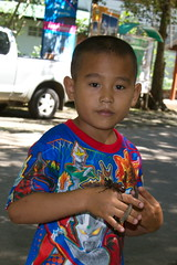 Boy and his pet, a Scarab beetle (asitrac) Tags: travel thailand asia southeastasia beetle siam th scarab maehongson scarabbeetle  maehongsonprovince asitrac watprathatdoikongmu
