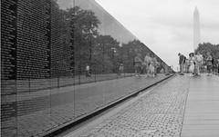 Wall Of The Dead (peterkelly) Tags: bw usa reflection brick stone wall digital dead death us dc washington districtofcolumbia unitedstates path unitedstatesofamerica tourists walkway northamerica soldiers names visitors washingtonmonument inscription vietnamwarmemorial