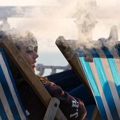 I see what you're saying... (hehaden) Tags: woman square sussex pier brighton candid smoke steam listening vapour striped deckchairs brightonpier palacepier electroniccigarette ecigarette