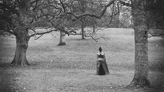 In The Open (Dell's Pics) Tags: park trees bw sculpture white black forest dark open air yorkshire lynn figure ix chadwick cloaked