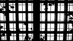 Grid (Dave G Kelly) Tags: people blackandwhite bw monochrome silhouette horizontal grid photography squares athens indoors greece walkway