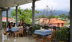 Breakfast on rooftop terrace of the Inlay Palace Hotel in Nyaung Shwe (Bn) Tags: road street travel people dog lake fish dusty rooftop bike architecture breakfast river season walking gold hotel pagoda town topf50 meer locals market terrace balcony burma stupa markets floating scooter tourist fresh busy rainy myanmar inlelake inle shan backpacker birma channel stepped shanstate chedi backpackers nyaungshwe nyaung yadana shwe 50faves guesthouses manaung mirrortiled paungdawseiqrd inlaypalace